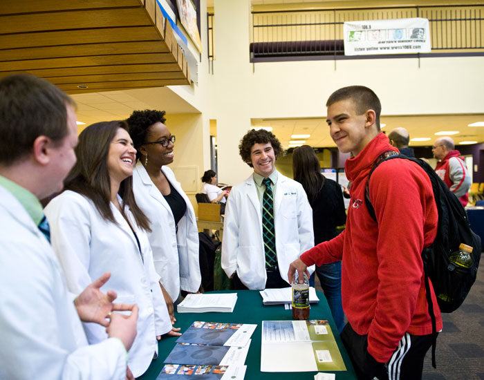 Student visiting vendor table
