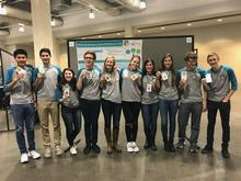 The Air Force Research Laboratory-Carroll High School iGEM team proudly displays their gold medals after the international iGEM competition in Boston Nov. 13, 2017. (U.S. Air Force photo/Richard Eldridge)